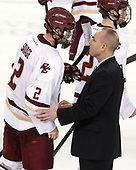 Scott Savage (BC - 2), Mike Cavanaugh (UConn - Head Coach), Mike Booth (BC - 12) - The Boston College Eagles defeated the visiting UConn Huskies 2-1 on Tuesday, January 24, 2017, at Kelley Rink in Conte Forum in Chestnut Hill, Massachusetts.