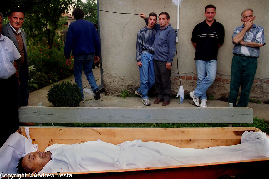 KOSOVO. Vushtri (Vucitern). 12/09/2000..The body of Shefki Popova, a 49 year old Albanian journalist who worked for the Rilindja newspaper lies in state before his burial. He was murdered two days previously by unknown assailants who shot him as he entered his flat..©Andrew Testa