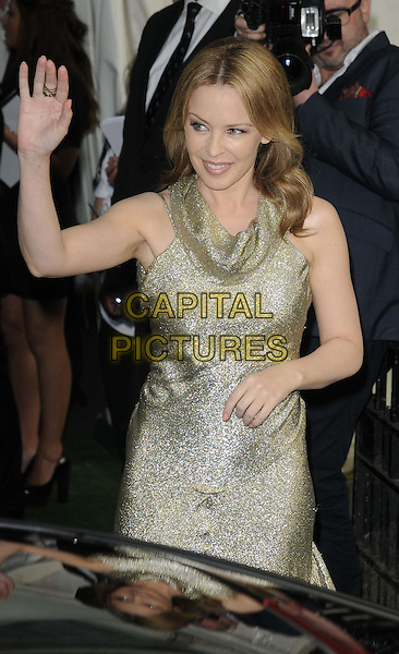 Kylie Minogue.The Glamour Women Of The Year Awards 2012, Berkeley Square Gardens, Berkeley Square, London, England..May 29th, 2012.half length gold dress sleeveless hand arm waving .CAP/CAN.©Can Nguyen/Capital Pictures.