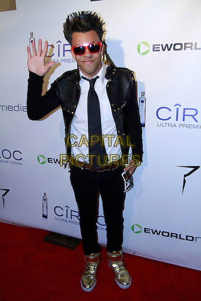 MICHAEL BENZ.The 2010 eWorld Music Awards at the famous Conga Room in downtown L.A., Los Angeles, California, USA..January 27th, 2009.full length white top black jeans denim jacket sunglasses shades hand palm waving tie gold trainers sneakers .CAP/ADM/RAT.©Ratianda/AdMedia/Capital Pictures.