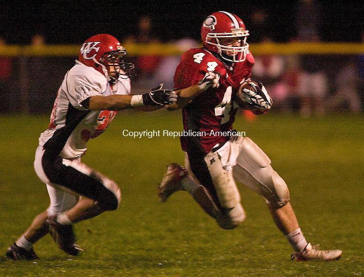 CHESHIRE, CT - 03 OCTOBER 2008 -100308JT03--<br /> Cheshire's Dan Sweeney runs out of bounds under pressure from Wilbur Cross' Juan Lugo during Friday's game at Cheshire.<br /> Josalee Thrift Republican-American