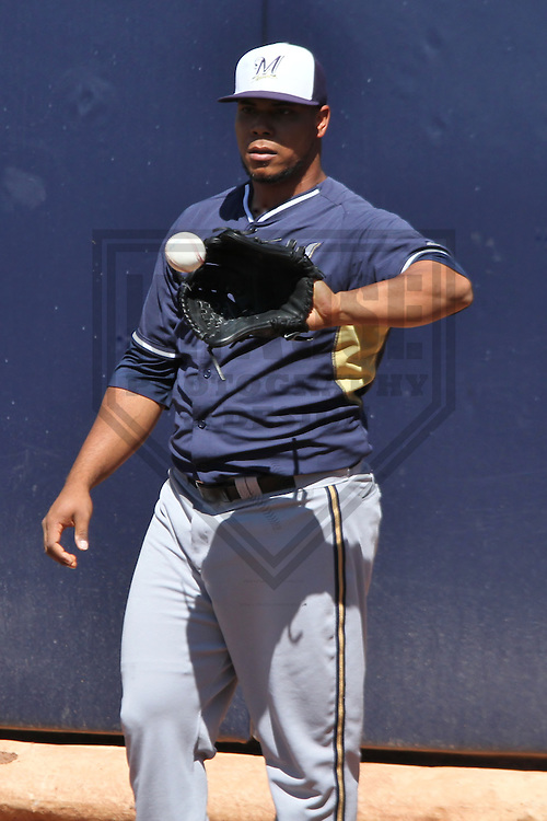 PEORIA - March 2014: Wily Peralta of the Milwaukee Brewers during a spring training game against the Seattle Mariners on March 19th, 2014 at Peoria Sports Complex in Peoria, Arizona.  (Photo Credit: Brad Krause)