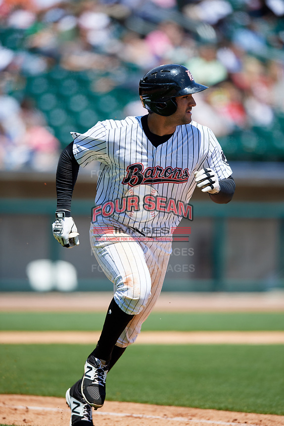 Birmingham Barons first baseman Nick Basto (25) runs to first base during a game against the Jacksonville Jumbo Shrimp on April 24, 2017 at Regions Field in Birmingham, Alabama.  Jacksonville defeated Birmingham 4-1.  (Mike Janes/Four Seam Images)