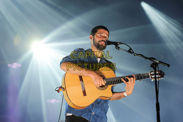 LONDON, ENGLAND - JULY 14: Nick Mulvey performing at Somerset House on July 14, 2015 in London, England.<br /> CAP/MAR<br /> &copy; Martin Harris/Capital Pictures