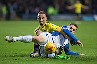 Kemar Roofe of Oxford United and Tom Lockyer of Bristol Rovers     battle for the ball during the Sky Bet League 2 match between Oxford United and Bristol Rovers at the Kassam Stadium, Oxford, England on 17 January 2016. Photo by Andy Rowland / PRiME Media Images.