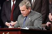 United States President George W. Bush signs H.R. 1588, the National Defense Authorization Act of Fiscal Year 2004 at the Pentagon in Arlington, Virginia on November 24, 2003.<br /> Credit: Ron Sachs / CNP