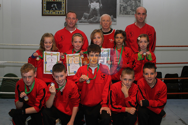 Lauren Kavanagh, Michaela Reynolds, Zoe Kavanagh, Shannon Reynolds, Shannon Stowe, Fionn Flynn, Blake Bissett, Gary Dunne, Andy Kirwan and Mason Traynor who all won trophies and medals in the Michael Andrews Tournament in the National Stadium in Dublin.  Pictured here with Brian Kavanagh, Darren Everitt and Jo Leonard at Drogheda Boxing Club...Picture Jenny Matthews/Newsfile.ie