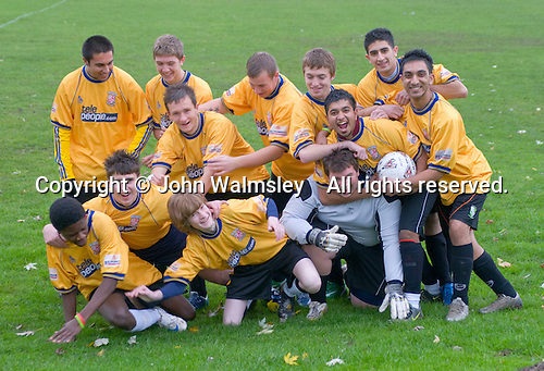 Having fun at the end of the football team photo.  Further Education College.