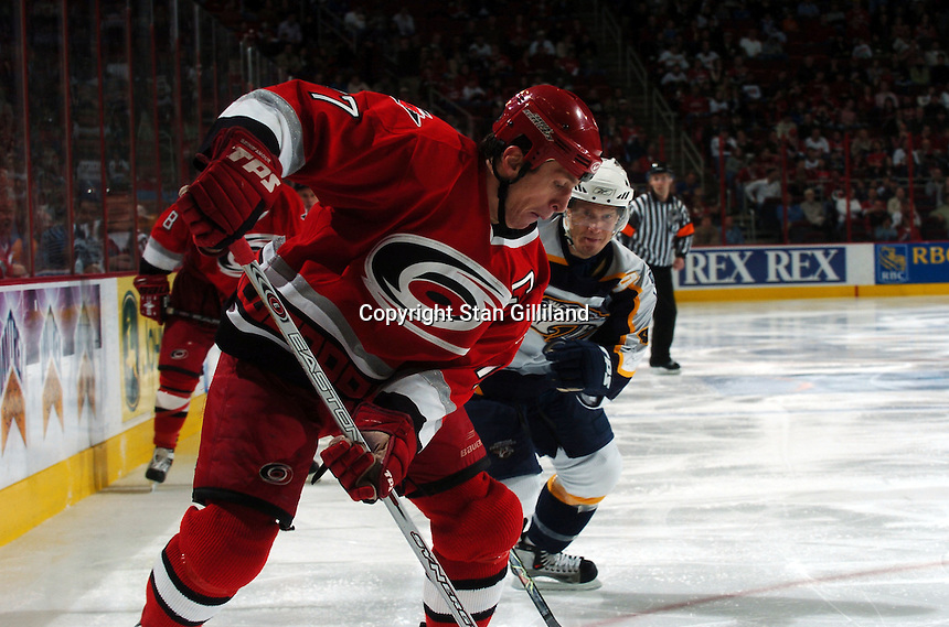 Rod Brind'Amour of the Carolina Hurricanes tries to get a pass off defended by the Nashville Predators Friday, January 13, 2006 in Raleigh, NC. Carolina won 5-4 after a shootout.