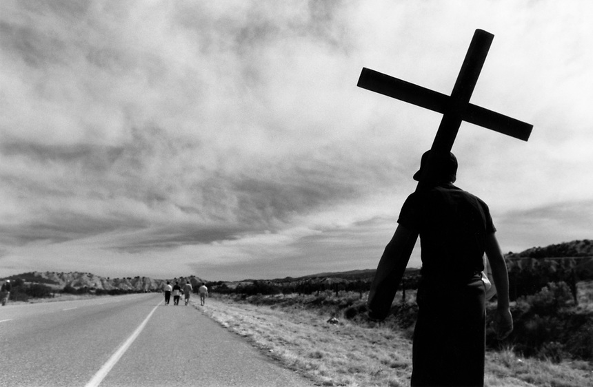 Chris Armijo started carrying his cross from the Santa Fe Opera complex at 4 a.m. Armijo said he carried the cross on the 25-mile journey for Jesus.