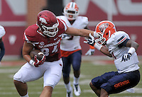 NWA Democrat-Gazette/BEN GOFF @NWABENGOFF<br /> Hunter Henry, Arkansas tight end, breaks the tackle of UTEP free safety Dashone Smith on Saturday Sept. 5, 2015 during the first quarter of the game in Razorback Stadium in Fayetteville.