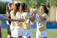 21 August 2011:  FIU's Kelly Ann Hutchinson (12) high-fives with teammates prior to the match.  The University of Florida Gators defeated the FIU Golden Panthers, 2-0, at University Park Stadium in Miami, Florida.