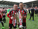 Sheffield United's John Fleck and Billy Sharp celebrate with the trophy during the League One match at Bramall Lane, Sheffield. Picture date: April 30th, 2017. Pic David Klein/Sportimage