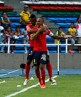 CALI -COLOMBIA-05-10-2014. Carlos Saa jugador de Uniautónoma celebra un gol anotado al Deportivo Cali durante partido por la fecha 13 de la Liga Postobón II 2014 jugado en el estadio Pascual Guerrero de la ciudad de Cali./ Uniautonoma player Carlos Saa celebrates a goal scored to Deportivo Cali during match for the 13th date of Postobon League II 2014 played at Pascual Guerrero stadium in  Cali city.Photo: VizzorImage/ Juan C. Quintero /STR