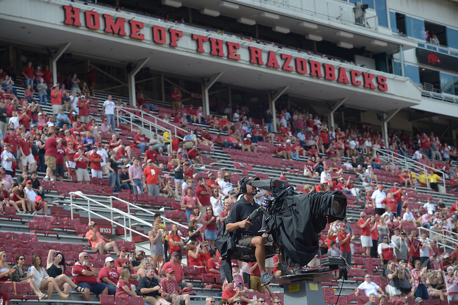 NWA Democrat-Gazette/ANDY SHUPE<br />An ESPN camera operator works atop a boom during the Arkansas-Alabama game Saturday, Oct. 6, 2018, during the fourth quarter at Razorback Stadium in Fayetteville. Visit nwadg.com/photos to see more photographs from the game.