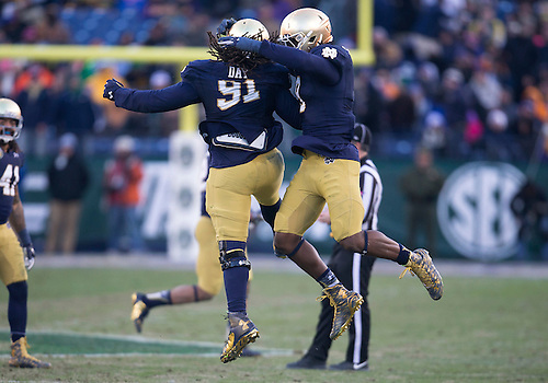 December 30, 2014:  Notre Dame defensive line Sheldon Day (91) and Notre Dame linebacker Jaylon Smith (9) celebrate during NCAA Football game action between the Notre Dame Fighting Irish and the LSU Tigers at LP Field in Nashville, Tennessee.  Notre Dame defeated LSU 31-28.