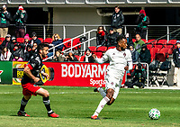 WASHINGTON, DC - FEBRUARY 29: Kellyn Acosta #10 of the Colorado Rapids moves the ball away from Felipe Martins #18 of DC United during a game between Colorado Rapids and D.C. United at Audi Field on February 29, 2020 in Washington, DC.