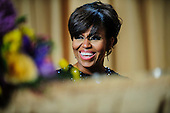 First Lady Michelle Obama reacts to a joke told by comedian Conan O'Brien during the White House Correspondents' Association (WHCA) annual dinner in Washington, District of Columbia, U.S., on Saturday, April 27, 2013..Credit: Pete Marovich / Pool via CNP