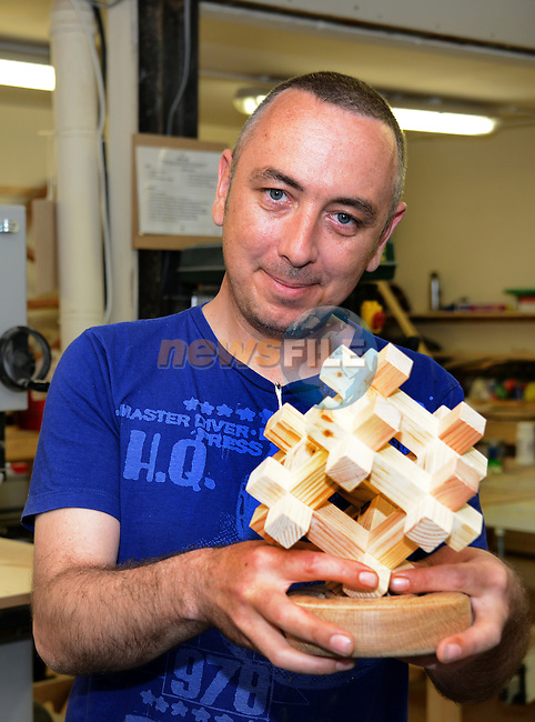 Charlie McEntegart of the Drogheda Men's Shed holding a prototype of the wooden hashtag award he designed for the Digital Times' Tweeties awards ceremony. www.newsfile.ie