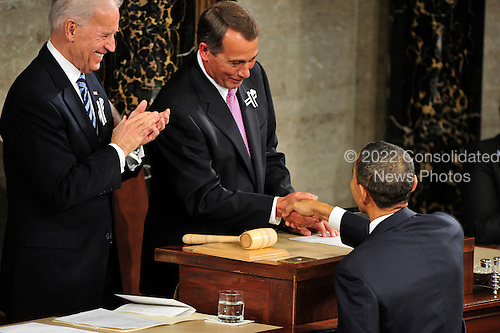 United States President Barack Obama shakes hands with U.S. Speaker of the House John Boehner (Republican of Ohio) prior to delivering the State of the Union Address to a Joint Session of Congress in the U.S. Capitol in Washington, D.C. on Tuesday, January 25, 2011.  U.S. Vice President Joe Biden applauds at left..Credit: Ron Sachs / CNP.(RESTRICTION: NO New York or New Jersey Newspapers or newspapers within a 75 mile radius of New York City)