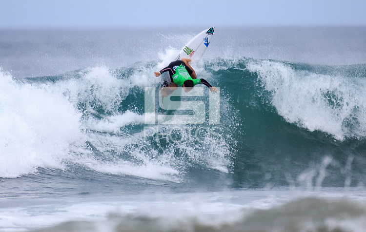 Huntington Beach, CA - Sunday July 30, 2017: Jhonny Corzo during a Qualifying Series (QS) trials round heat in the 2017 Vans US Open of Surfing on the South side of the Huntington Beach pier.