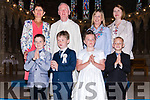 Pupils from Scoil an Ghleanna Cathal Furlong and Cillian Ó Dúill, Anna Ní Chonchúir from Bunscoil an Chlochar, and Tajus Grebliunas from Scoil Iognaid Rís, the day of their First Communion, here pictured with their teachers Maire Uí Chonchúir, Róisín Uí Bheaglaoí, Deirdre Ní Chinnéide, and an tAthair Seosamh Ó Beaglaoí at St. Mary's Church, Dingle, on Sunday afternoon.