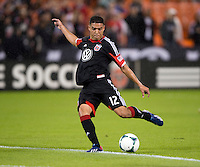Luis Silva (12) of D.C. United takes a shot during a Major League Soccer game at RFK Stadium in Washington, DC. D.C. United tied the Philadelphia Union, 1-1.