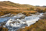A stream running down a valley on the Isle of Arran in Scotland in November.