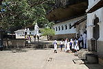 People at Dambulla cave Buddhist temple complex, Sri Lanka, Asia