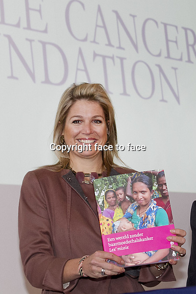 """Princess Maxima received the 1st copy of the book """"A world without (baarmoederhalskanker) cervical cancer"""" by Chantal Spieard and Lex Peters at the LUMC in Leiden.Prof. Lex Peters is founder of the female cancer foundation. Chantal Spieard followed Lex Peters for his female cancer foundation work. Leiden, 26.02.2013...Credit: Nieboer/PPE/face to face..- No Rights for Netherlands -"""
