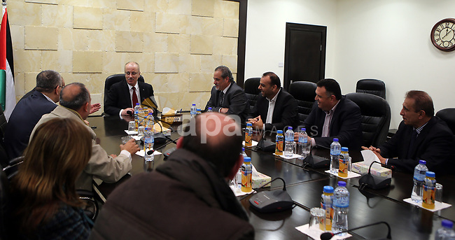 Palestinian Prime Minister Rami al-Hamdallah, meets with a delegation from the Popular Organizations, in the West Bank city of Ramallah on March 23, 2017. Photo by Prime Minister Office