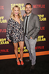 HOLLYWOOD, CA - APRIL 06:  Actress Brittany Daniel (L) and Adam Touni attend the premiere of Netflix's 'Sandy Wexler' at the ArcLight Cinemas Cinerama Dome on April 6, 2017 in Hollywood, California.