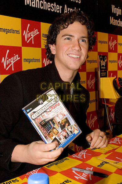 RICHARD FLEESHMAN.in Megastore at The Arndale Centre, Manchester, UK. .November 21st, 2006.half length coronation street game.CAP/AT.©Alan Towse/Capital Pictures