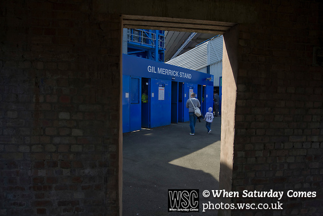 Birmingham City 1 Wolverhampton Wanderers 1, 01/05/2011. St Andrews, Premier League. Two home supporters making their way towards the turnstiles at the Gil Merrick stand at St. Andrew's stadium, prior to Birmingham City's Barclay's Premier League match with Wolverhampton Wanderers. Both clubs were battling against relegation from  England's top division. The match ended in a 1-1 draw, watched by a crowd of 26,027. Photo by Colin McPherson.