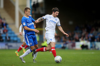 Matty Kennedy of Portsmouth takes the ball past Gillingham's Jake Hessenthaler during Gillingham vs Portsmouth, Sky Bet EFL League 1 Football at the MEMS Priestfield Stadium on 8th October 2017