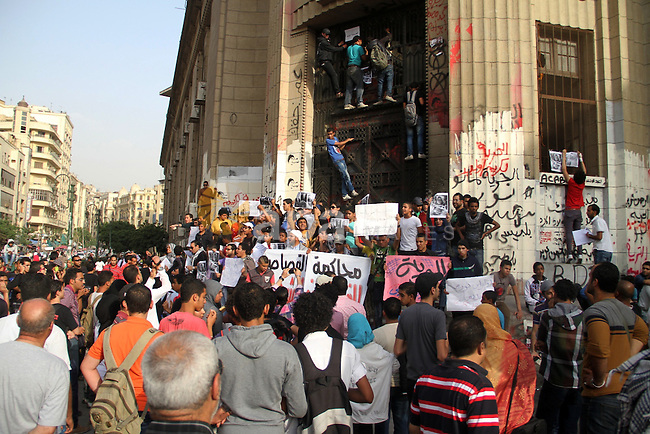 Students hold placards during a protest in front ofthe High court demanding the release of students arrested in previous violent demonstrations and to increase the political independence of the universities, on April 28, 2013 in Cairo. Photo by Tareq Gabas