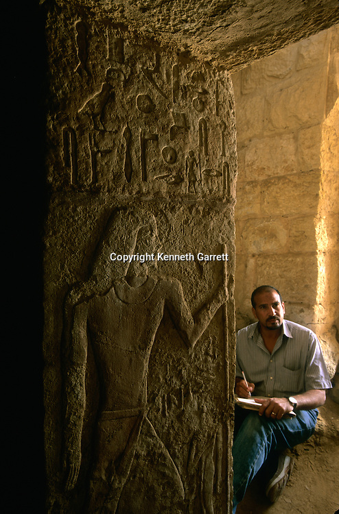 Tomb of Weser-Peteh described as the one whom the king knows, honored one by the great god and overseer of the officials looks out on eternity from the doorway of his tomb in the upper section of the builder's cemetery, Giza, Egypt, Zahi Hawass