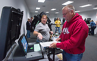 NWA Democrat-Gazette/BEN GOFF @NWABENGOFF<br /> Kim Dennison, election coordinator, directs Donald Mayberry of Rogers where to insert his ballot into the scanner and tabulator machine Saturday, Nov. 3, 2018, at the Benton County Election Commission office in Rogers. Early voting continues through Monday for Tuesday's general election.