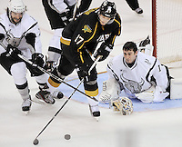 San Antonio Rampage goaltender Dov Grumet-Morris, right, loses his mask as he guards the net against Texas Stars' Tomas Vincour (17) during the third period of an AHL hockey game, Saturday, Oct. 13, 2012, in San Antonio. Texas won 2-1. (Darren Abate/pressphotointl.com)