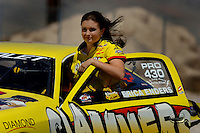 Apr 8, 2006; Las Vegas, NV, USA; NHRA Pro Stock racer Erica Enders returns to her pit area after qualifying her Slammers Ultimate Milk Chevrolet Cobalt at the Summitracing.com Nationals at Las Vegas Motor Speedway in Las Vegas, NV. Mandatory Credit: Mark J. Rebilas