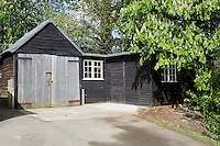 Exterior of a free-standing wooden garage.
