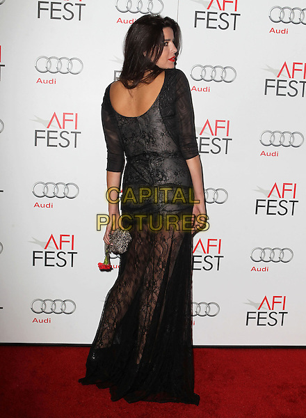 Anabela Moreira.AFI FEST 2012 'On The Road' gala screening, Grauman's Chinese Theatre, Hollywood, California, USA..3rd November 2012.full length dress black lace back behind rear looking over shoulder .CAP/ADM/KB.©Kevan Brooks/AdMedia/Capital Pictures.