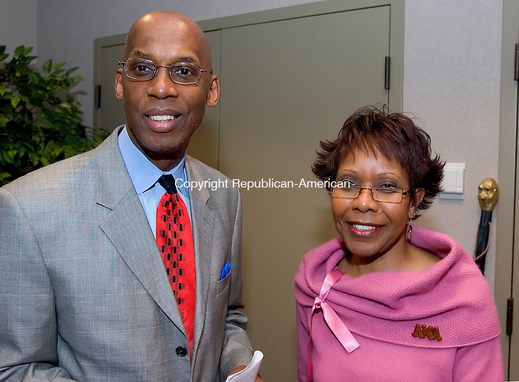 WATERBURY, CT  08 FEBRUARY 2005 -020806JS09--Maurice Mosley Esq. of the Kappa Alpha Psi Fraternity, left, with Carolyn Griffin of the Alpha Kappa Alpha Sorority at the Black Greek-Letter Night at the Timexpo Museum in Waterbury.   --- Jim Shannon Republican-American --Carolyn Griffin, Maurice Mosley are CQ
