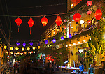 Many of the streets and the waterfront in Hoi An, and the shops and restaurants that line them, are brightly lit at night with lanterns and other lights. Here we see Nguyen Thai Hoc street with its colorful silk lanterns.
