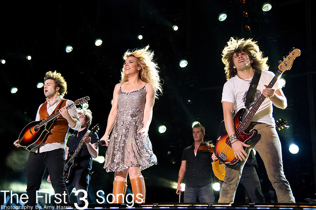 Neil Perry, Kimberly Perry and Reid Perry of The Band Perry performs at LP Field during Day Four of the 2013 CMA Music Festival in Nashville, Tennessee.