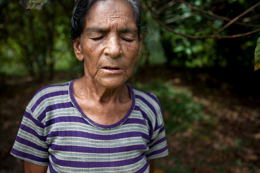 Florinda Yela, 75, outside her house which sits above the contaminated Aguarico 4 pit outside Lago Agrio, Ecuador.
