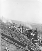 D&amp;RG construction train near Marshall Pass summit.  There appear to be ties and rails on the train as well as many ties along the track, both neatly stacked and randomy tossed.<br /> D&amp;RG  Marshall Pass, CO