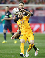 Atletico de Madrid's Yannick Carrasco (b) and FC Barcelona's Jordi Alba during Champions League 2015/2016 Quarter-Finals 2nd leg match. April 13,2016. (ALTERPHOTOS/Acero) <br /> Madrid 13/4/2016 Vicente Calderon <br /> Football Calcio 2015/2016<br /> Champions League Quarti di finale <br /> Atletico Madrid - Barcellona <br /> Foto Alterphotos / Insidefoto <br /> ITALY ONLY