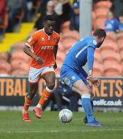 Blackpool's Marc Bola under pressure from Peterborough United's Jason Naismith<br /> <br /> Photographer Kevin Barnes/CameraSport<br /> <br /> The EFL Sky Bet League One - Blackpool v Peterborough United - Saturday 13th April 2019 - Bloomfield Road - Blackpool<br /> <br /> World Copyright &copy; 2019 CameraSport. All rights reserved. 43 Linden Ave. Countesthorpe. Leicester. England. LE8 5PG - Tel: +44 (0) 116 277 4147 - admin@camerasport.com - www.camerasport.com