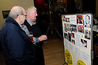 30th. Anniversary of the Miners' Strike<br /> End of Strike Social<br /> Florence Sports and Social Club<br /> Stoke on Trent<br /> Part of a season of events commemorating the 30th anniversary of the miners' strike of 1984 - 1985.<br /> Members of the audience view photographs of strikers and their supporters of those who have died since the strike.